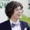 http://www.hotgossip.com/harry-styles-loves-nothing-better-than-giving-one-directions-tour-bus-a-good-clean/10883/