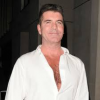 http://www.hotgossip.com/is-simon-cowell-about-to-marry-pregnant-girlfriend-lauren-silverman/11605/