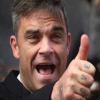 Robbie Williams Takes Unusual Steps To Combat Weight Issues