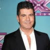 http://www.hotgossip.com/simon-cowell-takes-extreme-measures-to-protect-his-beloved-dogs/12230/