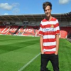 http://www.hotgossip.com/which-one-direction-star-set-to-invest-in-hometown-football-club/12306/