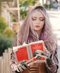 Grimes Explains the Photos of Her Reading 'The Communist Manifesto'